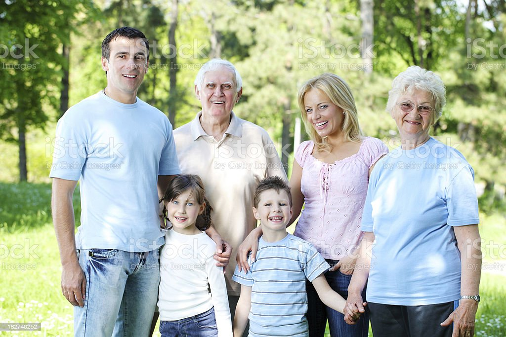 Extended happy family standing in the park. royalty-free stock photo