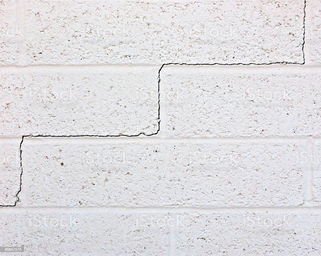 exterior brick wall with crack stock photo