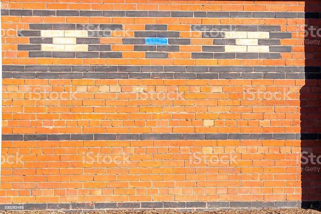 Exterior brick wall with geometric pattern. stock photo