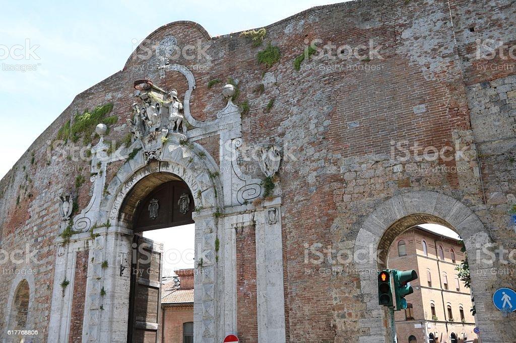 Exterior facade of city gate Porta Camollia, Siena Tuscany Italy stock photo