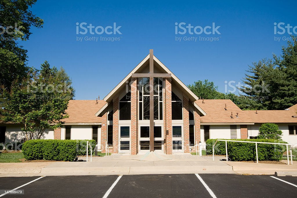 Exterior Modern Church A-Frame Gabled Roof, Metal Cross stock photo