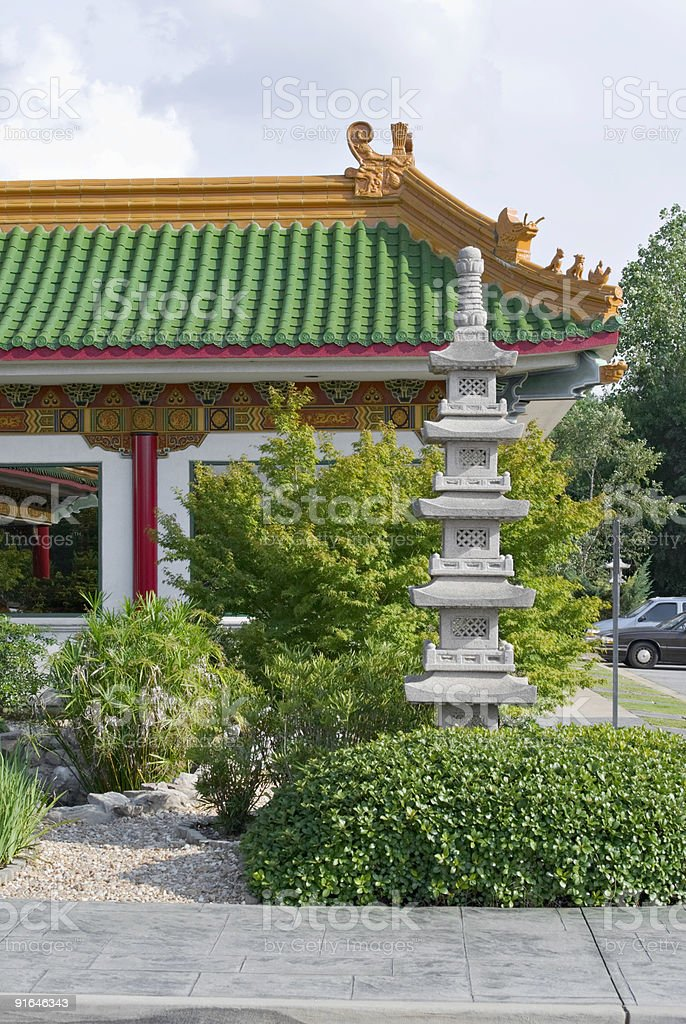 Exterior of a Chinese restaurant and a landscaped garden stock photo