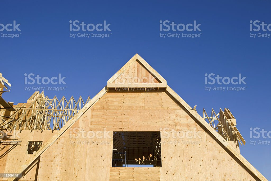 Exterior of a Large Home Construction Gable against Blue Sky stock photo