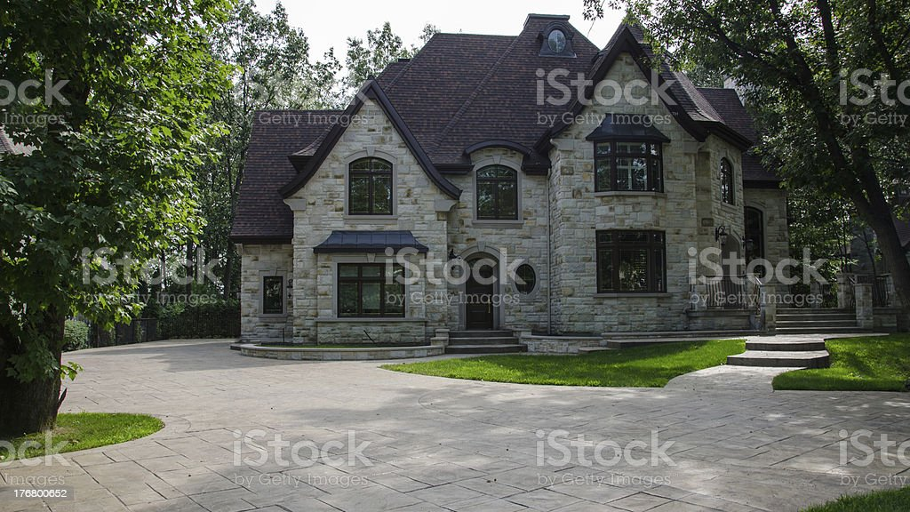 Exterior of a large, luxury brick mansion with wide grounds royalty-free stock photo