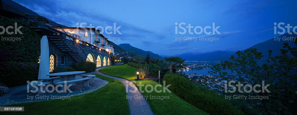 Exterior of a modern house in the night stock photo