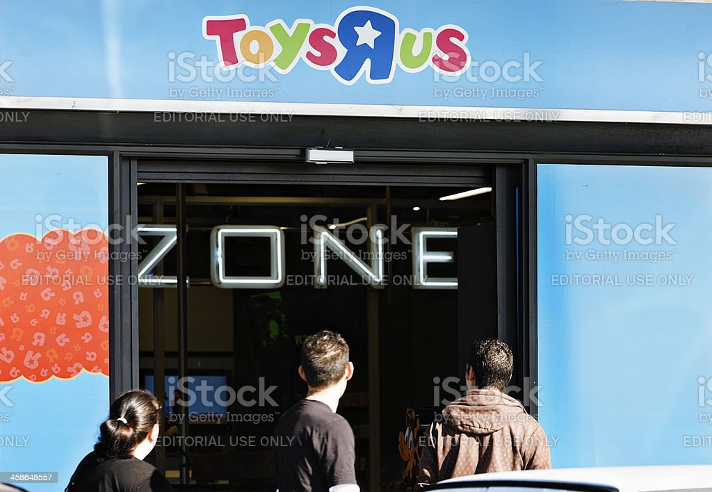 """Exterior of a Toys """"R"""" Us store with customers approaching royalty-free stock photo"""