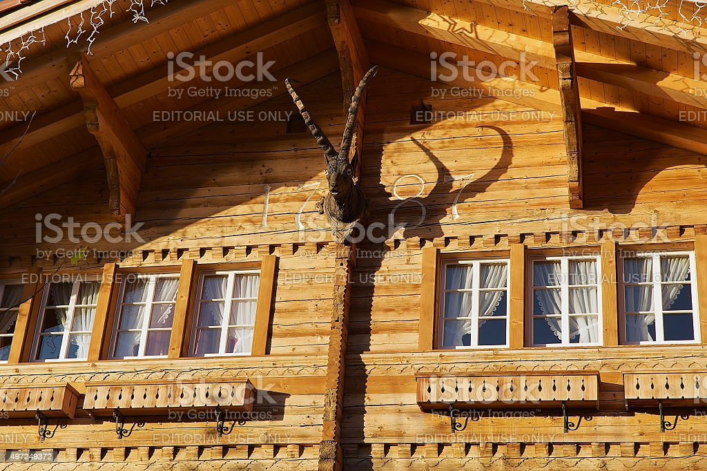Exterior of a traditional Swiss wooden chalet in Brienz, Switzerland. stock photo