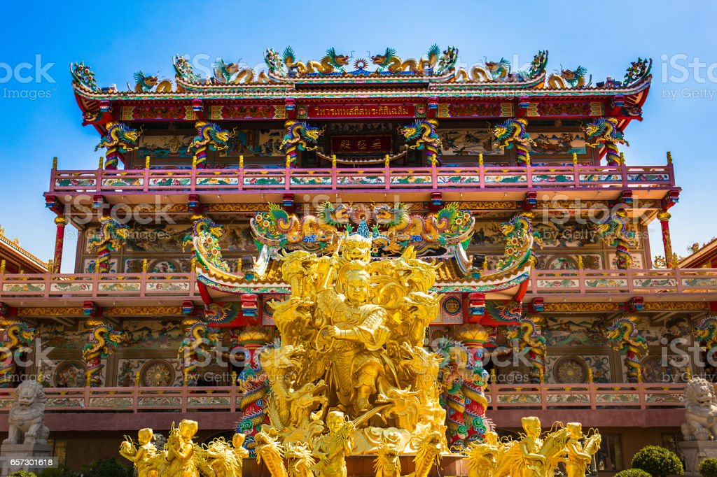Exterior of Chinese Buddhism temple in Thailand, Gold statue stock photo