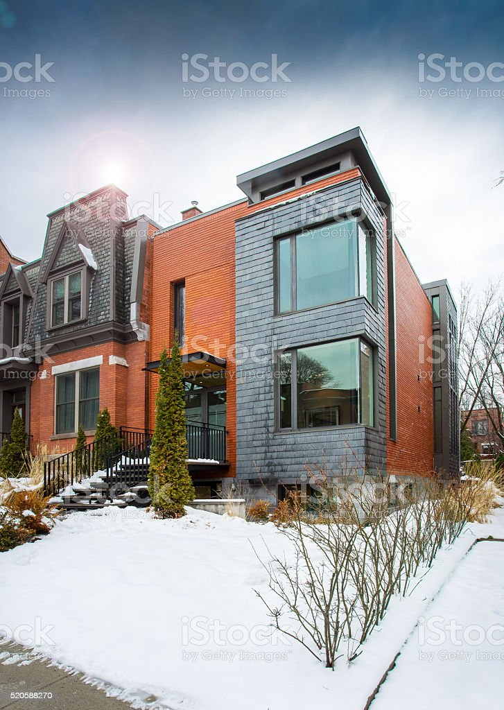 Exterior of contemporary style townhouse in winter. stock photo