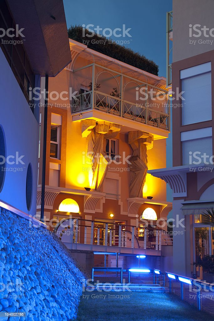 Exterior of Modern Illuminated Building at Night royalty-free stock photo