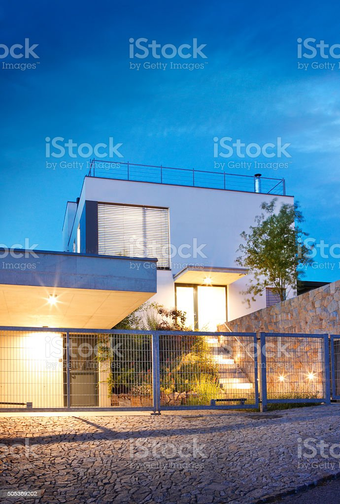 Exterior of new modern house by dusk stock photo
