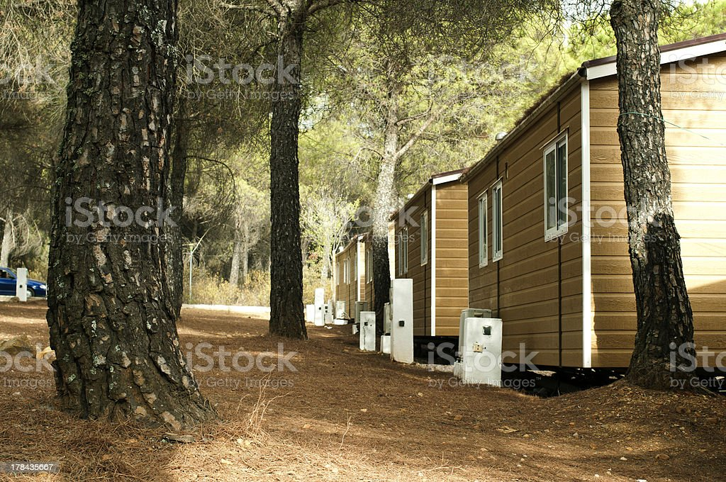 Exterior of the rear side of mobile homes with a few trees stock photo