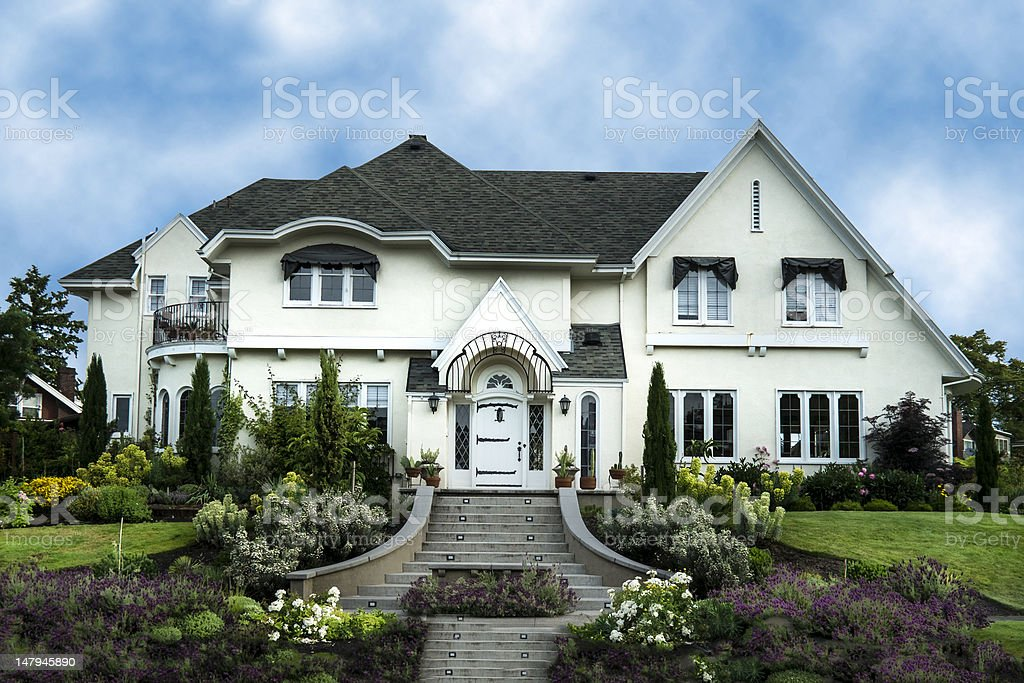 Exterior of white stucco luxury house stock photo