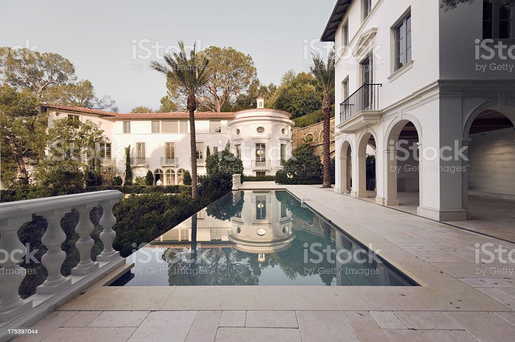 Exterior photo of a Bel Air mansion featuring a pool stock photo