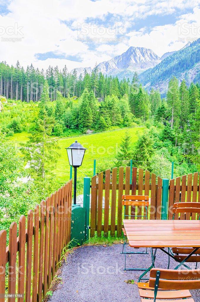 Exterior restaurant and green alpine meadows stock photo