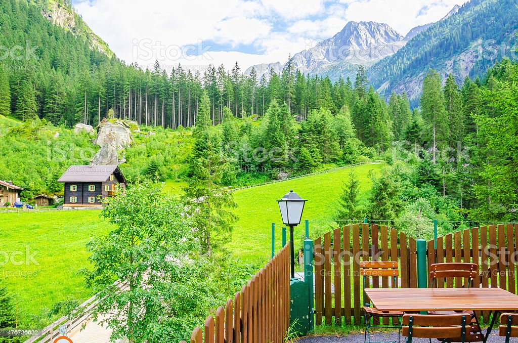 Exterior restaurant and high peaks of the alps stock photo
