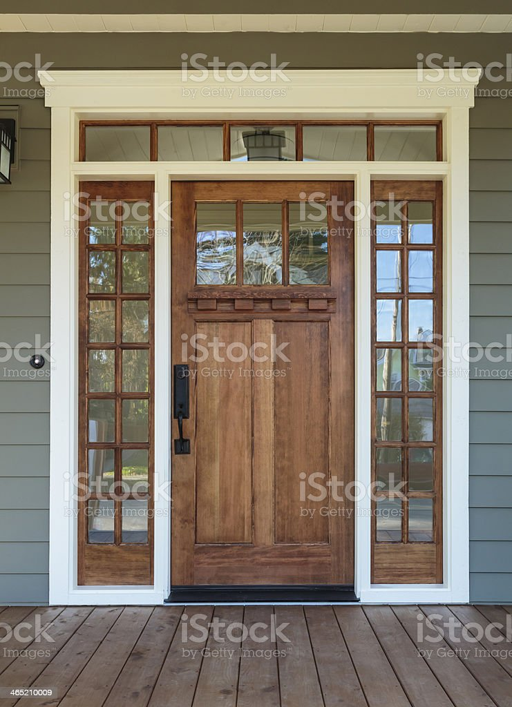 Exterior shot of a Wooden Front Door on Upscale Home stock photo