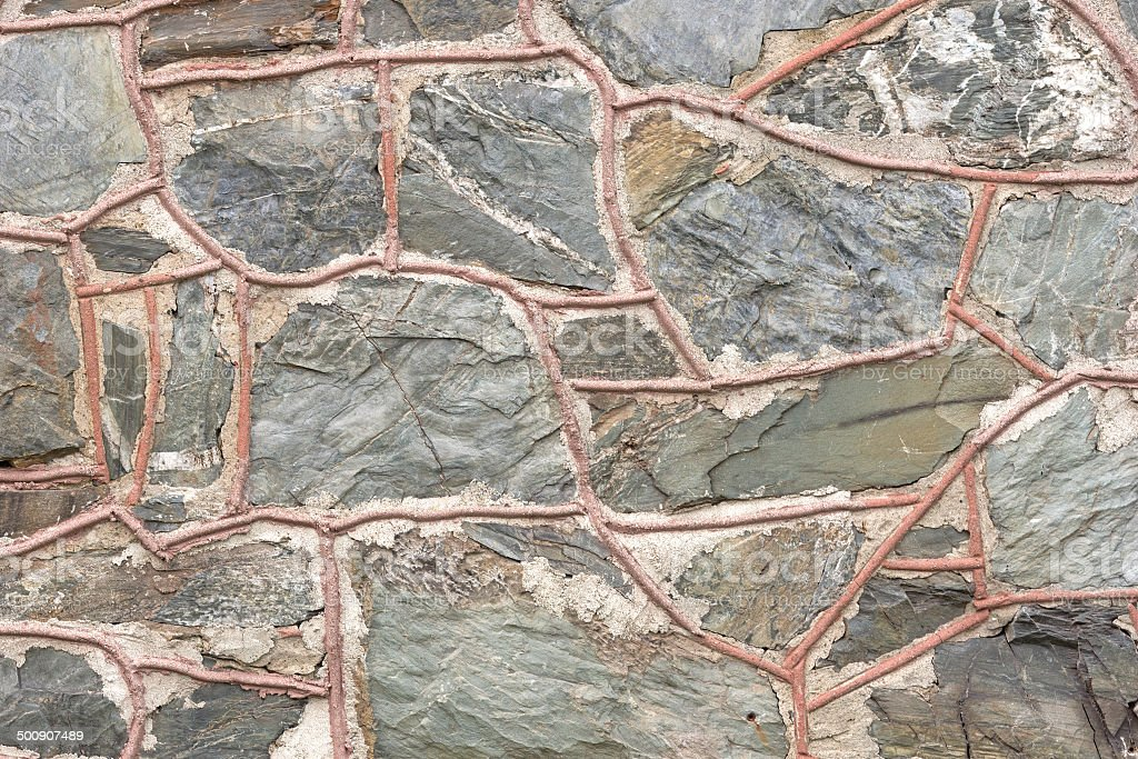 Exterior stone wall with thick grout stock photo