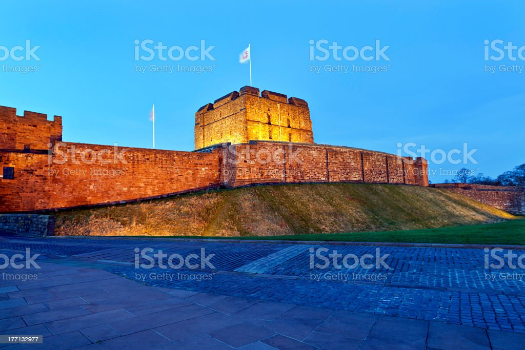 Exterior view of Carlisle Castle lit up at night stock photo