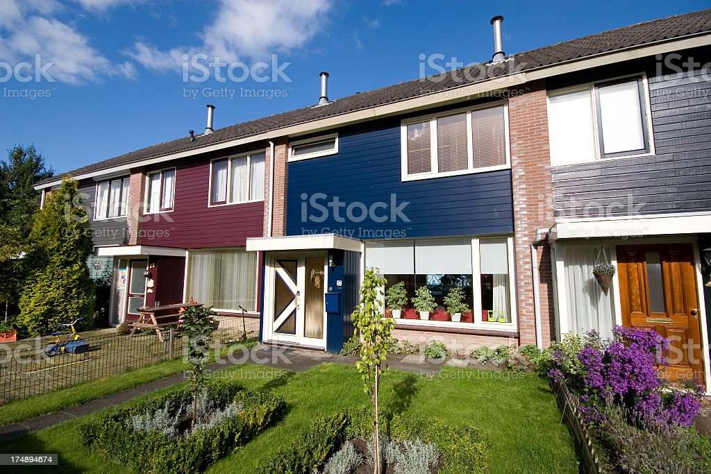 Exterior view of multicolored Dutch homes connected together stock photo
