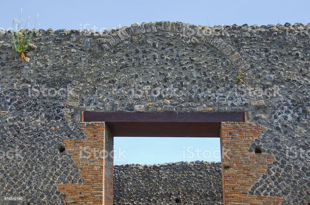Exterior Wall, Arch and Door at Pompeii, Italy stock photo