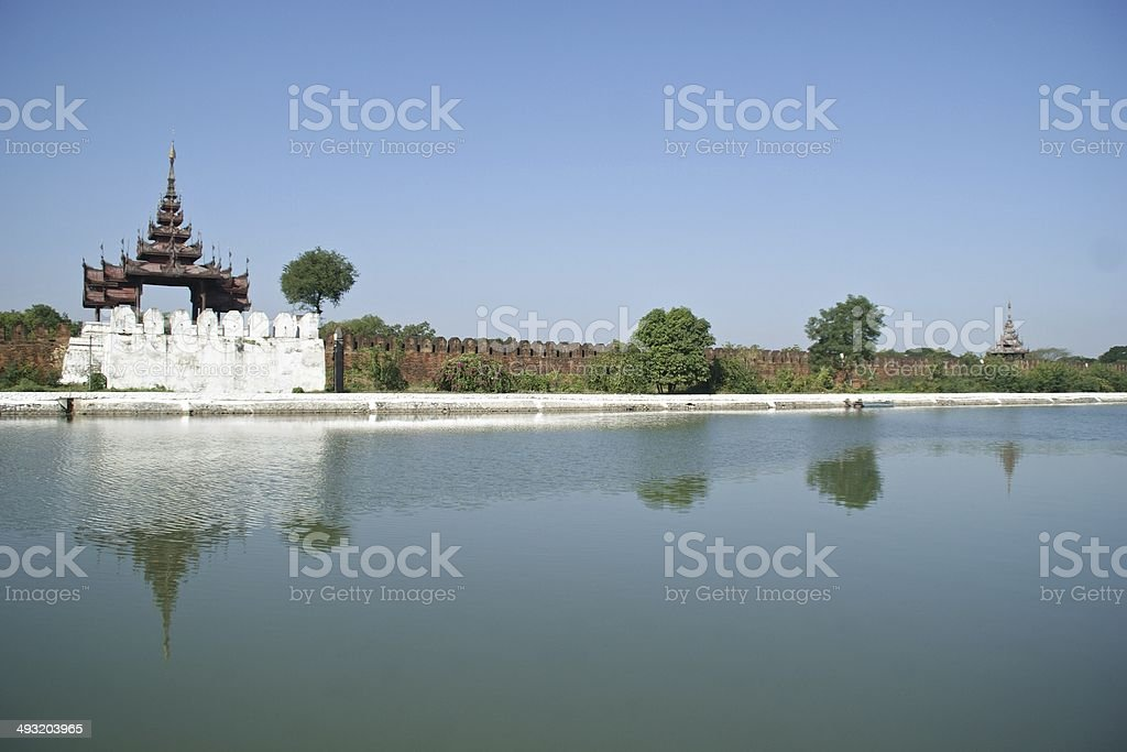 Exterior wall of Mandalay Palace, with reflections in the moat royalty-free stock photo