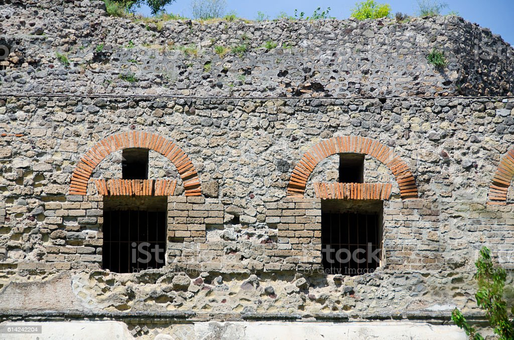 Exterior Wall, Windows and Doors at Pompeii, Italy stock photo