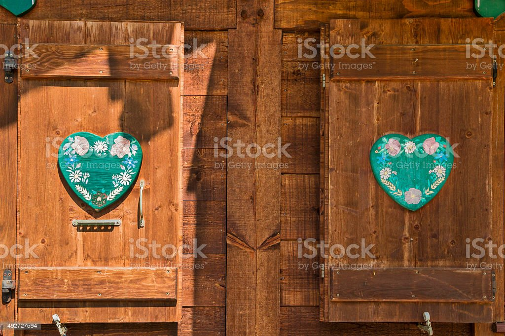 Exterior wooden windows  with ornaments stock photo