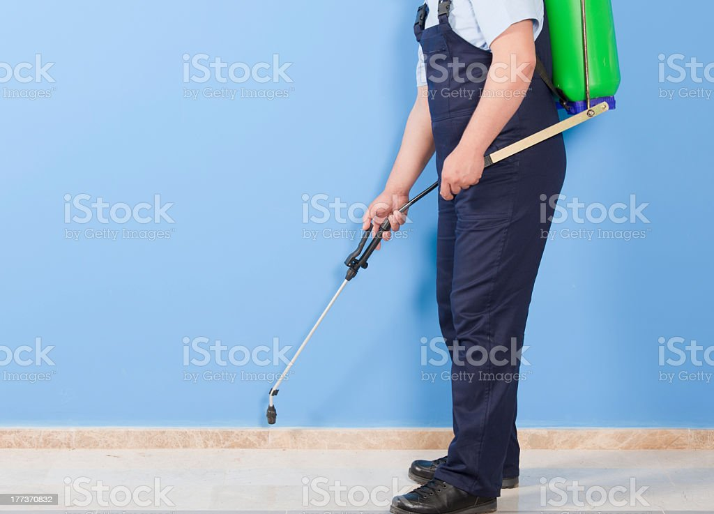 A exterminator doing some pest control work stock photo