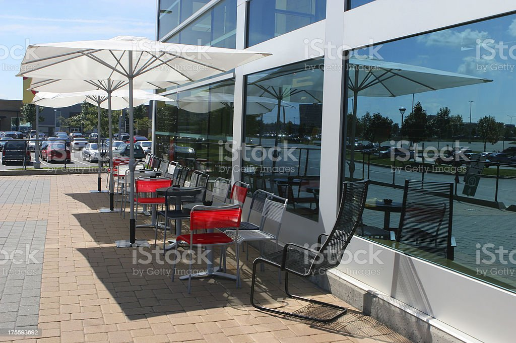 External bistro terrace with umbrellas table and chairs royalty-free stock photo
