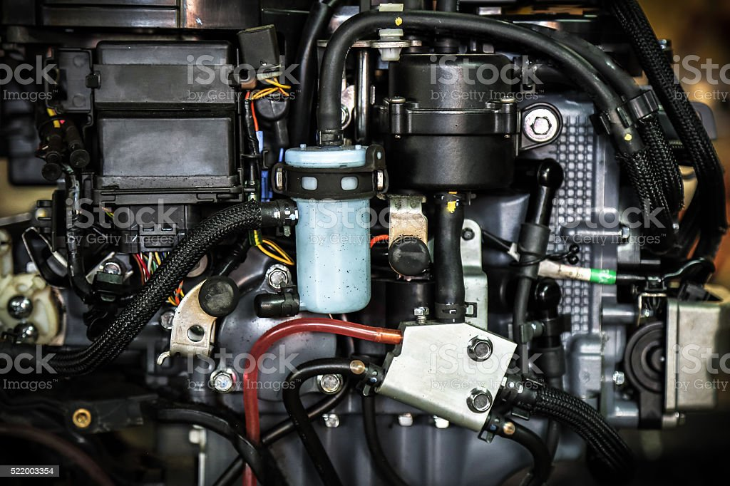 External components of modern outboard engine stock photo