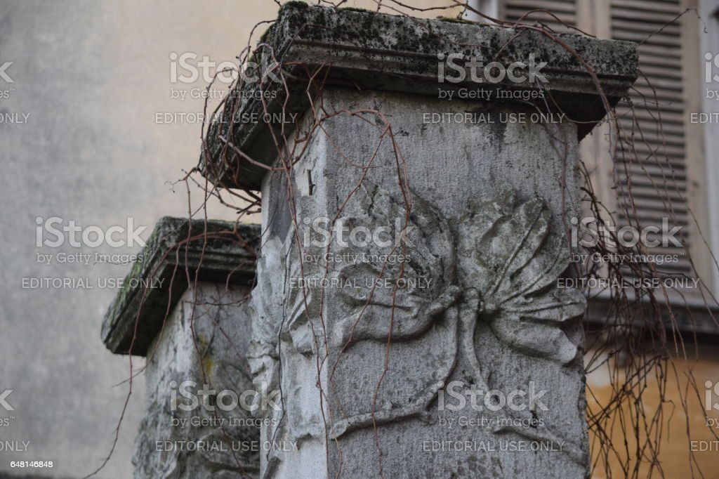 external enter to a buildind, columns with art-deco stoneworks stock photo