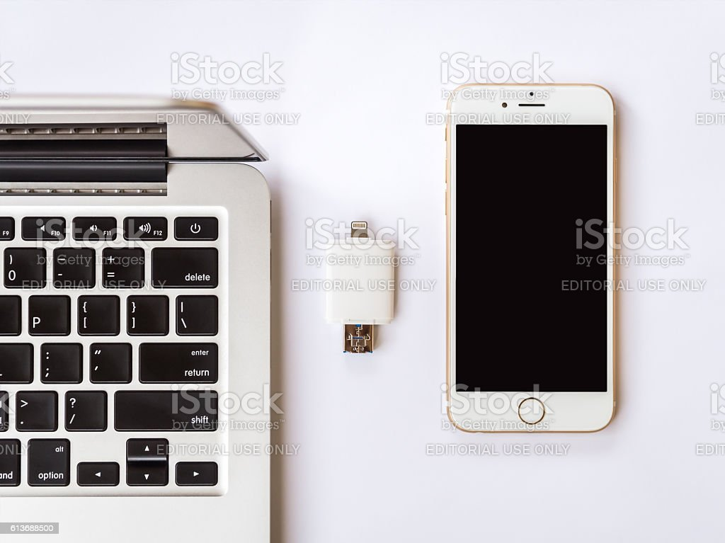 External storage between with iPhone and Macbook stock photo