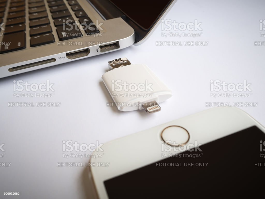 External storage transfering with iPhone and Macbook stock photo
