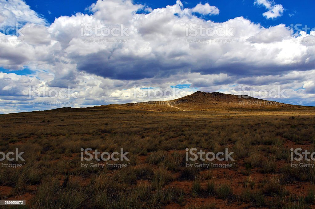 Extinct Volcano with Ray of Sunlight and Clouds stock photo