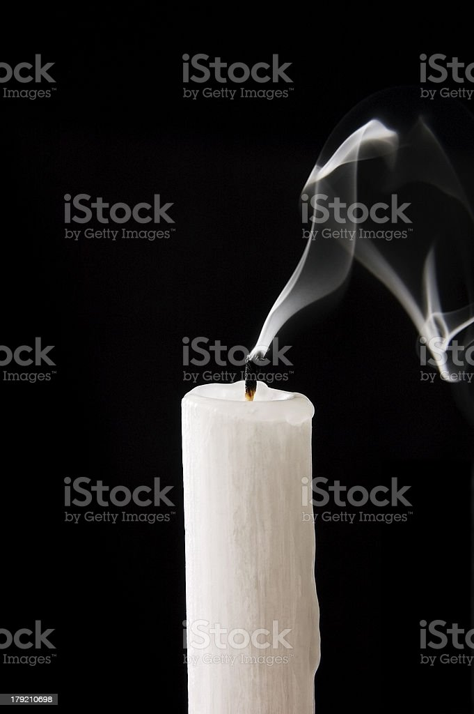 Extinguished candle stock photo