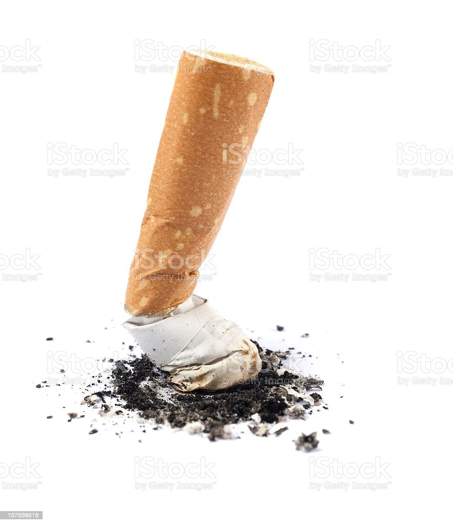 Extinguished cigarette butt isolated on white background royalty-free stock photo