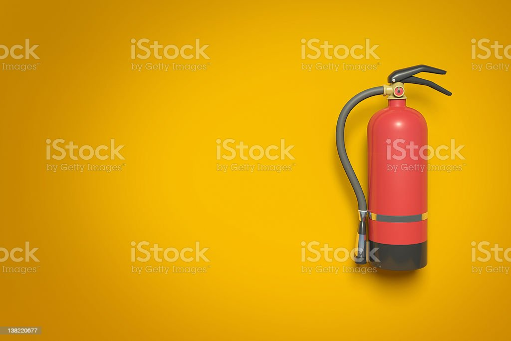 Extinguisher on a wall stock photo