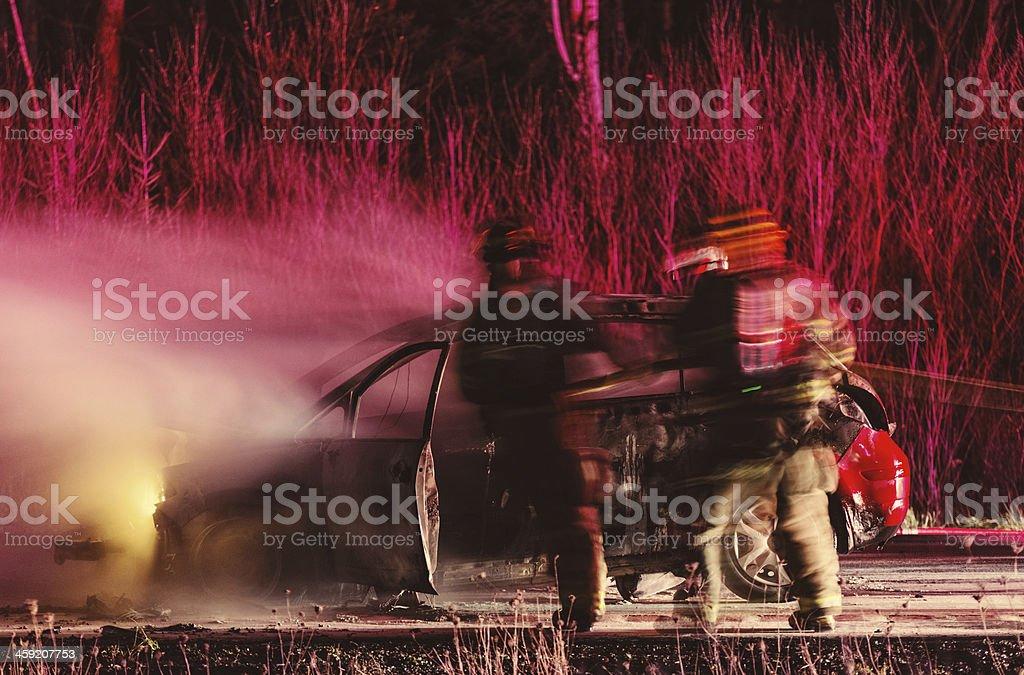 Extinguishing Car Fire royalty-free stock photo