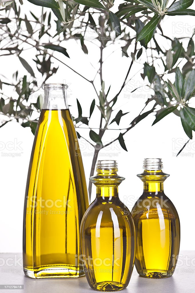 Extra Virgin Olive Oil And  Branch With Leaves royalty-free stock photo