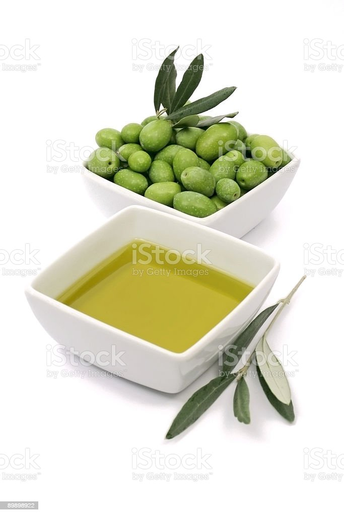 Extra virgin olive oil and green olives royalty-free stock photo