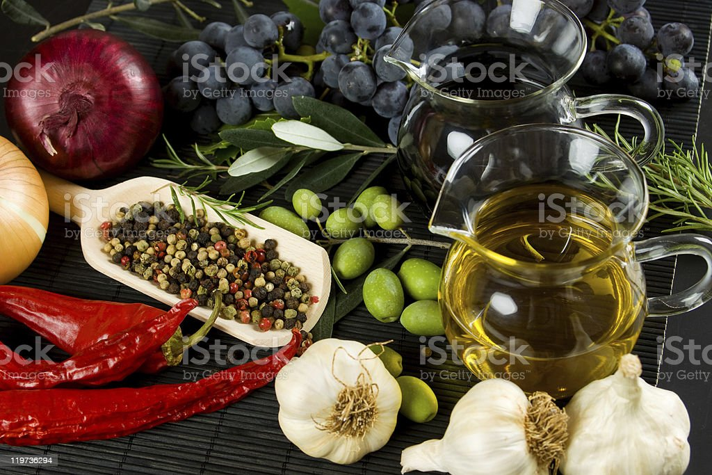 Extra virgin olive oil and mediterranean food ingredients royalty-free stock photo