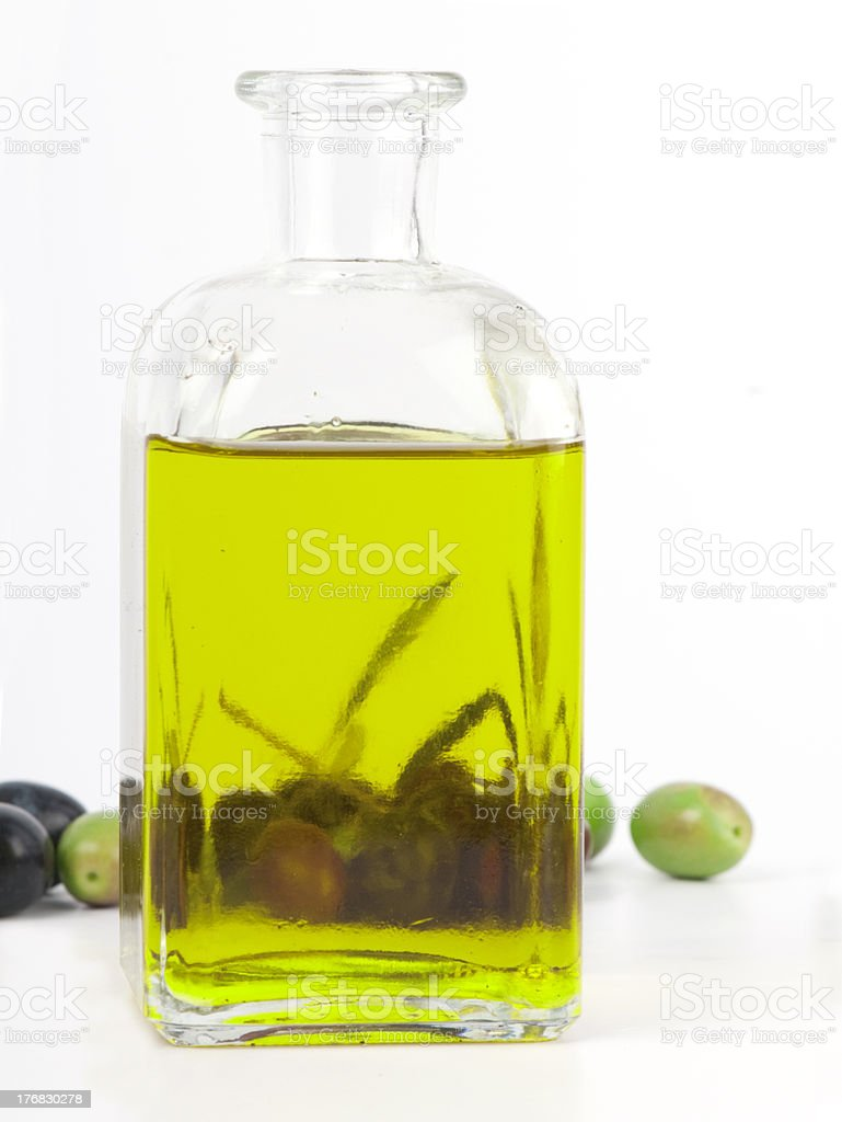 Extra virgin olive oil in a glass jar with olives. stock photo