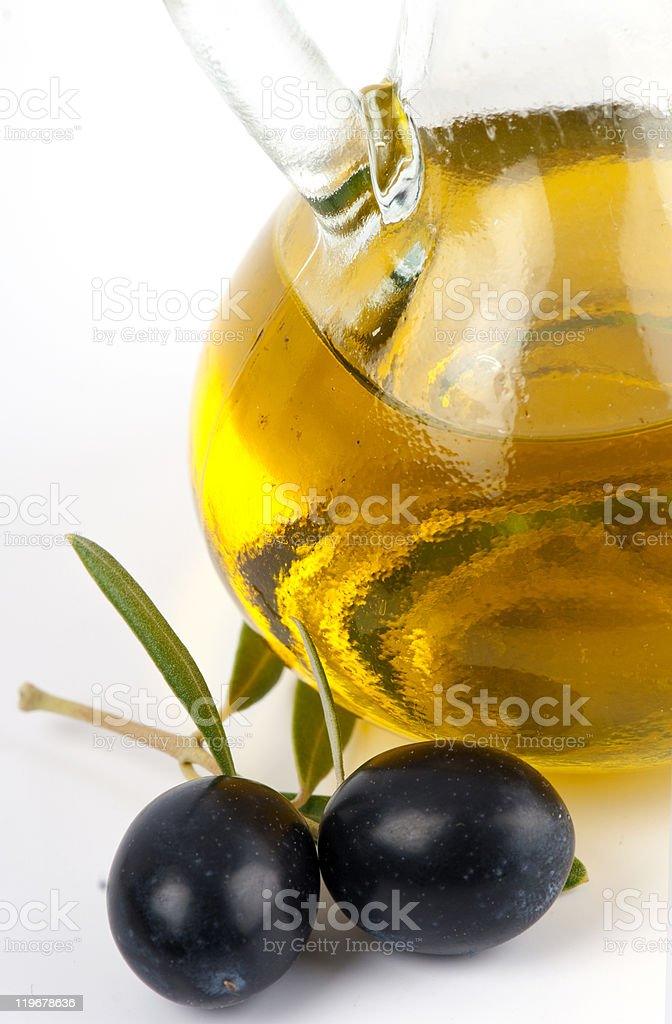 Extra virgin olive oil in  glass jar with  black olives. stock photo