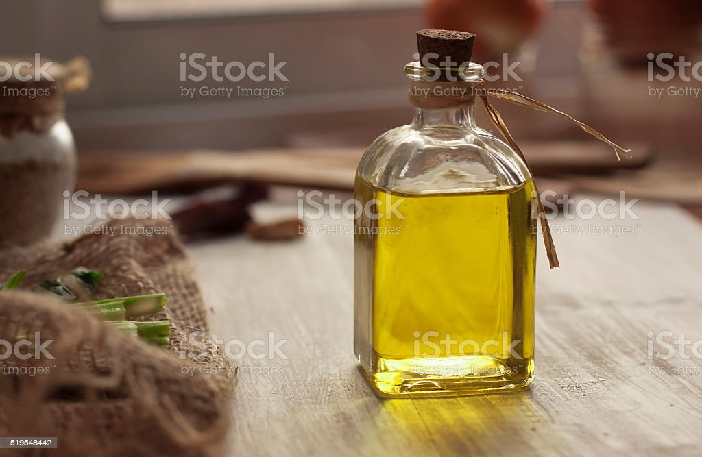 Extra virgin olive oil on rustic background stock photo