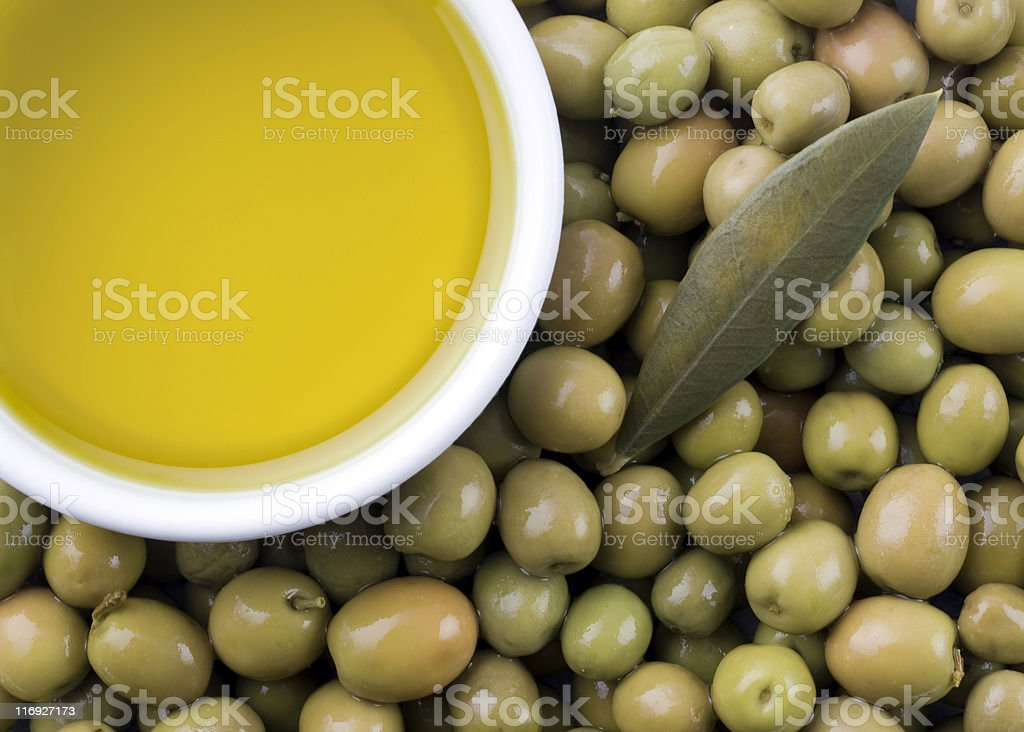 Extra virgin pure olive oil and olives stock photo