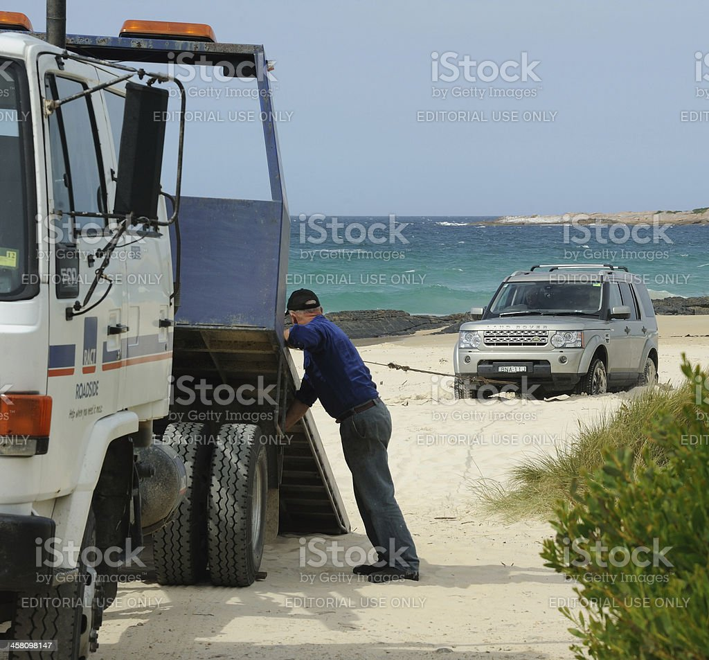 Extracting a Land Rover from the beach stock photo
