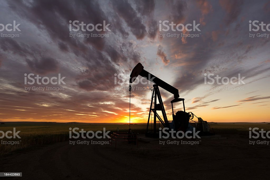 Extracting petrol during the sunset stock photo