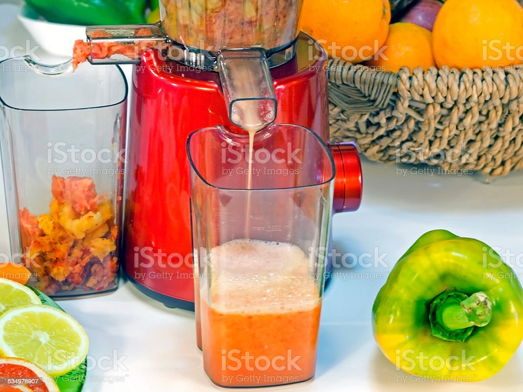 extractor low rpm in working produces fresh juice without oxidation stock photo