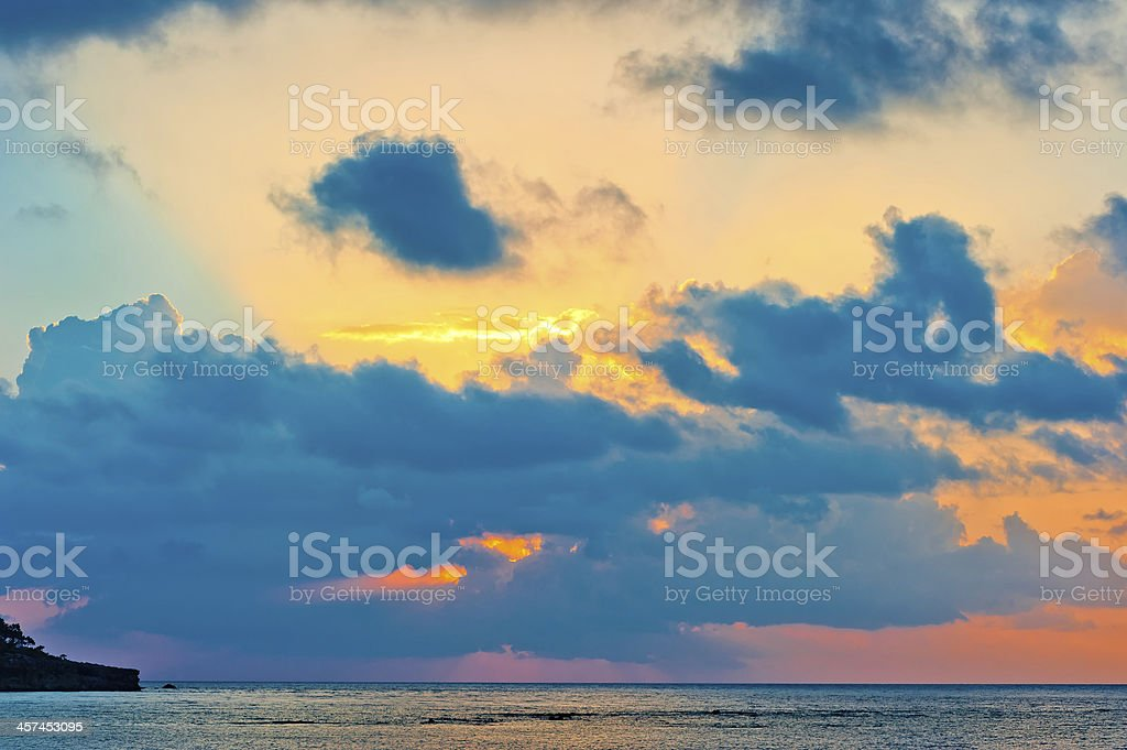 extraordinarily beautiful sky at sunrise over the calm sea royalty-free stock photo